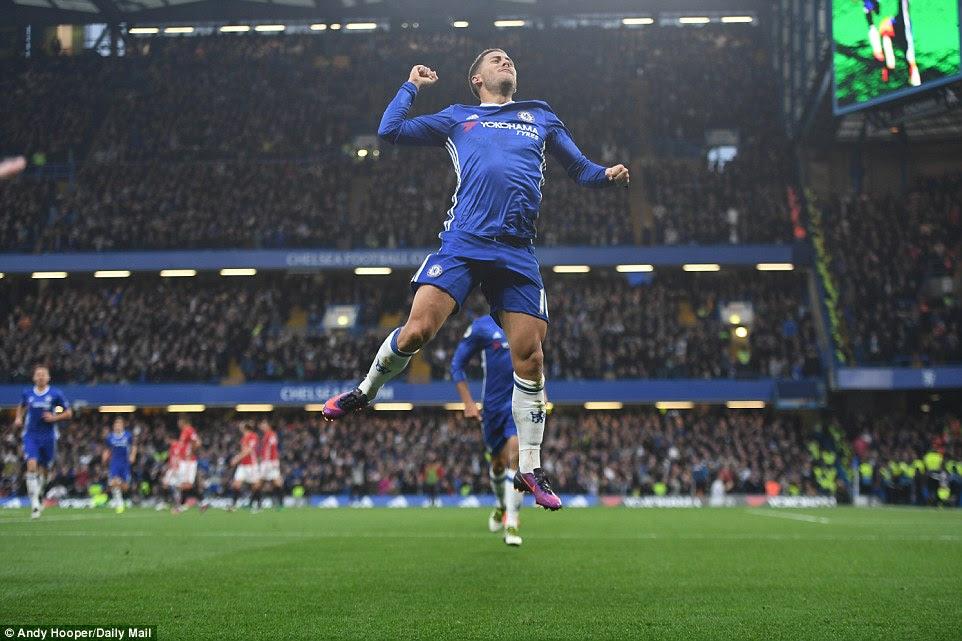 Hazard jumps for joy after putting Chelsea 3-0 ahead against United just after the hour mark