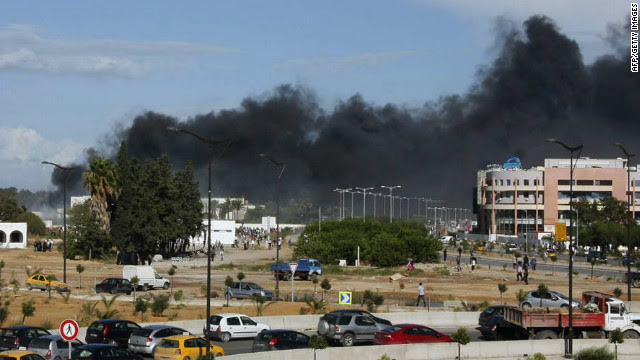 Smoke rises from the U.S. Embassy in Tunisia's capital during Friday protests against a film mocking Islam.