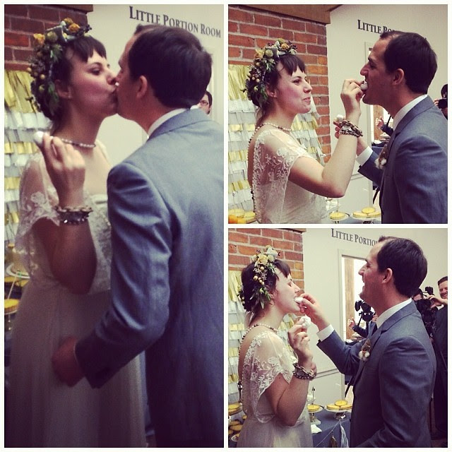 Feeding each other mini powdered donuts after cutting our cake - #wedding #ryanandceleste #yum