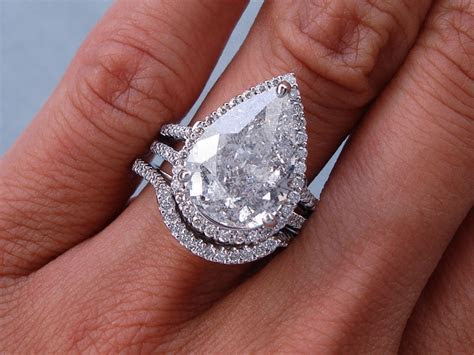 5.93 CTW PEAR SHAPE DIAMOND WEDDING RING SET (Includes a