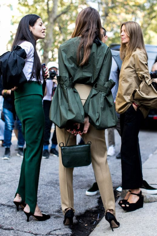 Le Fashion Blog Mfw Street Style Green Top With Oversized Sleeves Khaki Pants Black Pumps Leather Bag Via Vogue Paris