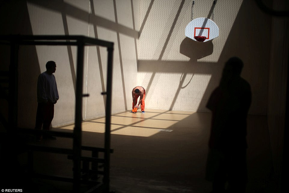 Detainees exercise in a recreation area at the Adelanto immigration detention center, which is run by the Geo Group Inc in California on April 13