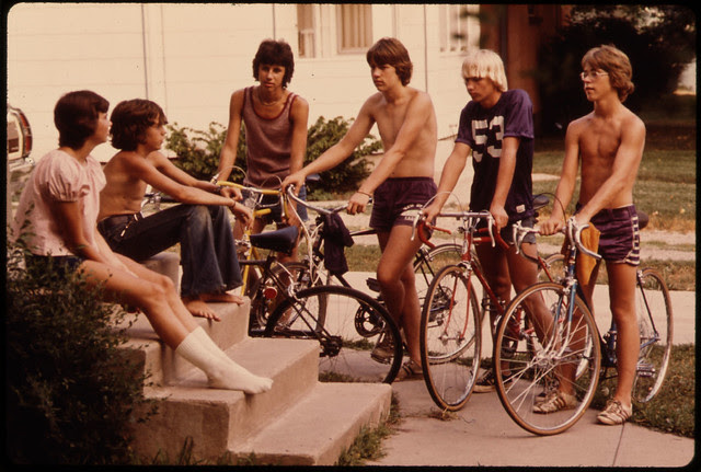 Youths Congregate Around the Front Steps of a Home in New Ulm, Minnesota, to Decide What to Do on a Summer Day...