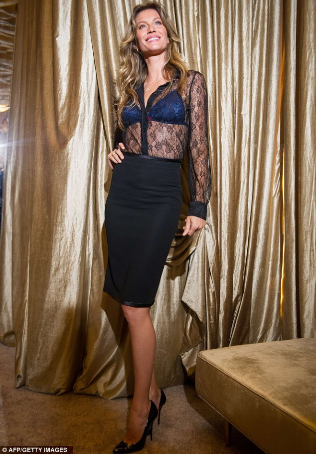 Sheer delight: Gisele modelled a midnight blue bra under a black lace blouse which she teamed with a pencil skirt