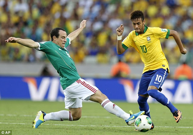 Running: Neymar tries to get away from Mexico's Gerardo Torrado