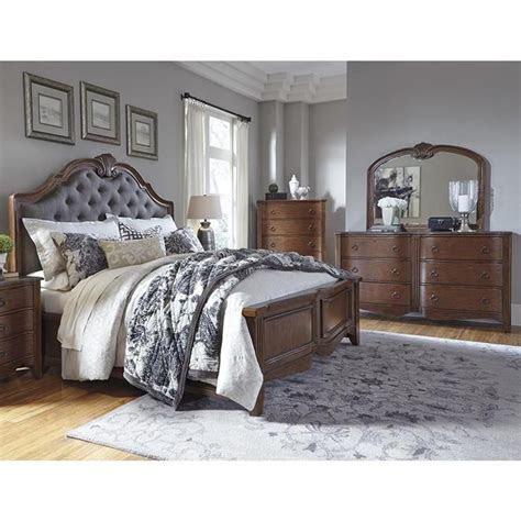 balinder  piece king panel bedroom set  medium brown