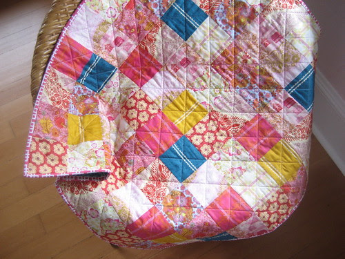 little folks quilt on the chair