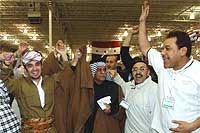 jubilant Iraqis exit the polls