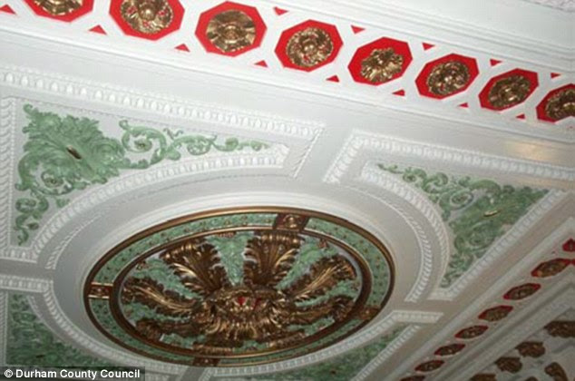Elegant decor: One of several ornate ceilings within the beautiful building