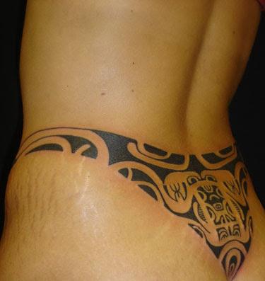 Tribal Hawaiian Tattoo On Girl Lowerback