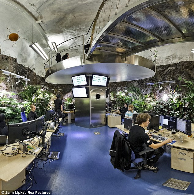 Plant life: The offices feature lunar-landscape flooring, glass corridors and a 'floating' conference room