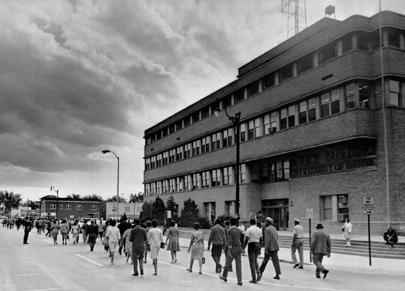 Description of  JUN 25 1968 - Black marchers walk past Denver Police Building on last leg of march. The group demanded replacement of white officers with black in their area and pledged to offer assistance. (Dave Buresh/The Denver Post)