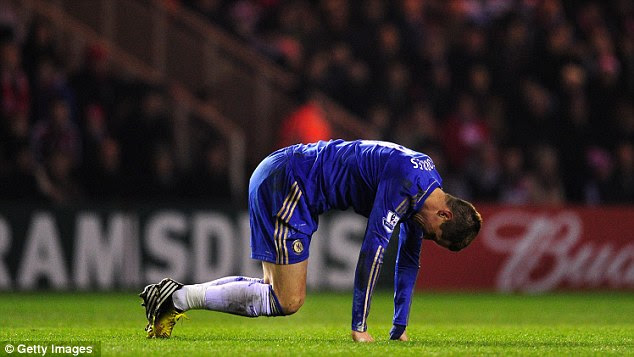 Chin up: Maybe after his 'goal' Torres will find his feet