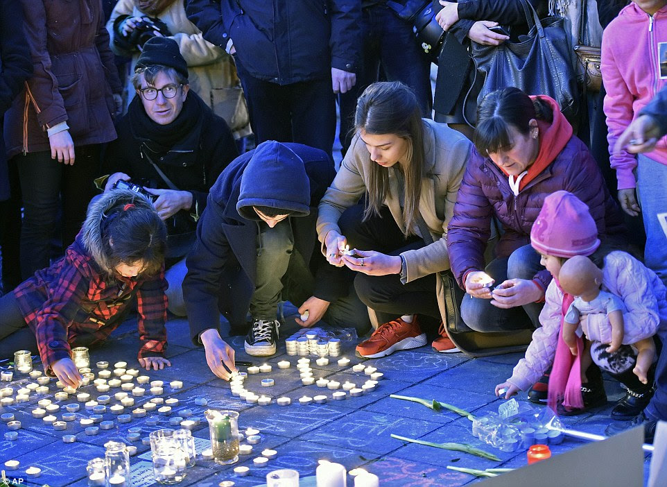 Young and old: Mourners of all ages turned out to thePlace de la Bourse in Brussels today to pay tribute to those were tragically killed