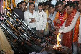 hindus offering prayers to guns