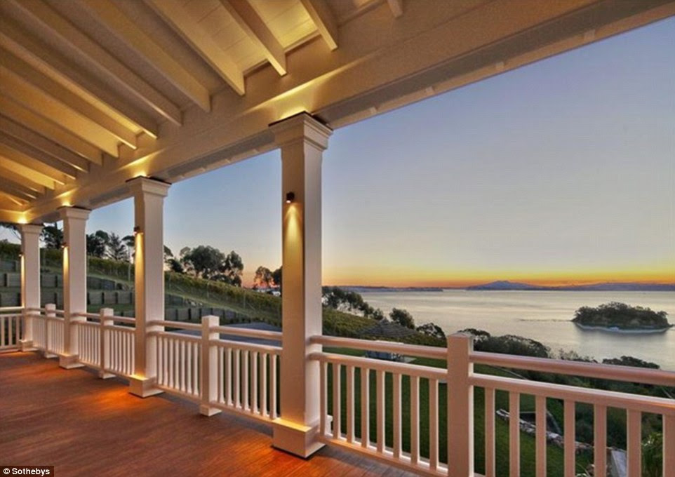 Island living: This plantation-style house looks across the bay to Auckland from the island of Waiheke, and boasts a 'boutique' winery, four bedrooms, a home theatre and a private art gallery
