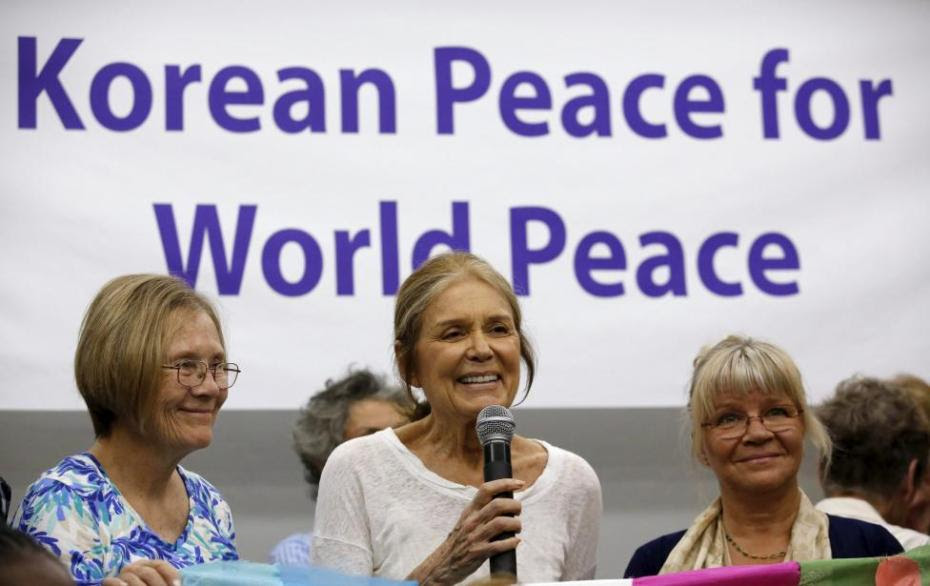 Activist and feminist Gloria Steinem (C) speaks at a news conference before the WomenCrossDMZ group leaves for North Korea's capital Pyongyang, at a hotel in Beijing, China, May 19, 2015.  REUTERS/Kim Kyung-Hoon
