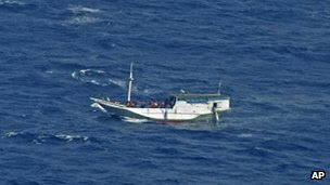 Photo released by the Indonesian National Search And Rescue Agency of a wooden boat believed to have up to 180 asylum seekers on board, off Christmas Island, Australia, 4 July, 2012