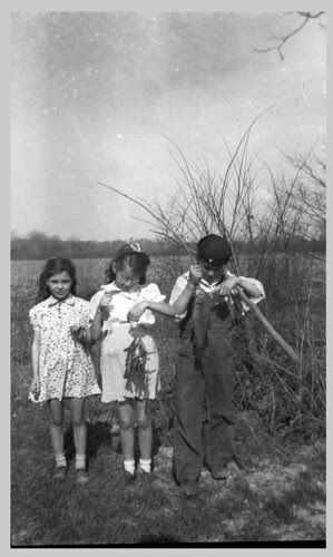 Three children and the catch.
