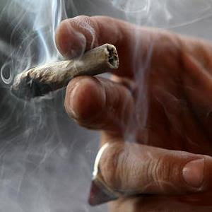 A medicinal marijuana user smokes at the Berkeley Patients Group in Berkeley, Calif., on March 25, 2010 (© Justin Sullivan/Getty Images)