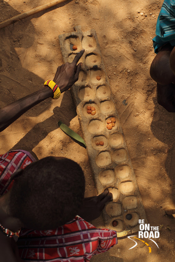 This game played with seeds and compartments is only played by the elderly men of the Samburu tribe