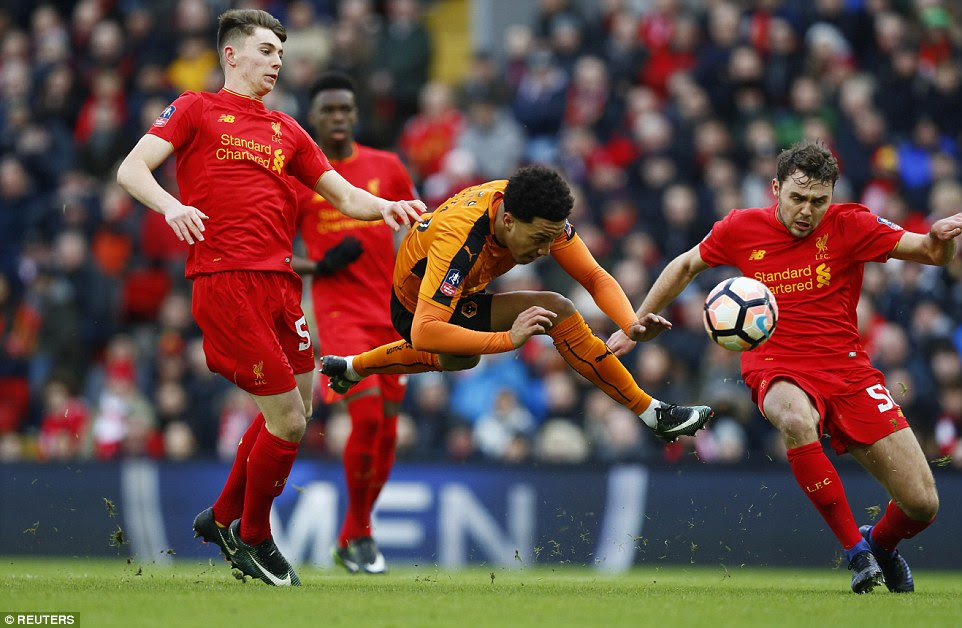 Wolves winger Helder Costa takes a tumble in the penalty area as he shapes to shoot under pressure from Ben Woodburn