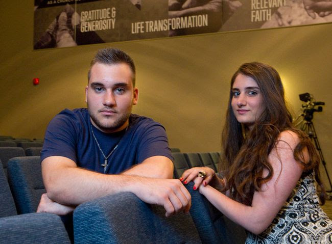 Nineb Yousef, 18, left, and Ninwe Yousef, 20, an Assyrian brother and sister who arrived in Canada in January after leaving their home in Tel Temir, Syria, have each been awarded four year scholarships to study at Western University. (CRAIG GLOVER, The London Free Press)