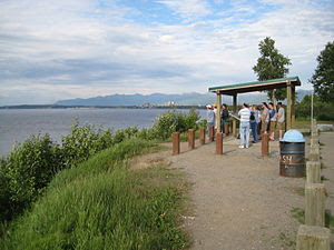 A Cook Inlet overlook with Anchorage in the ba...