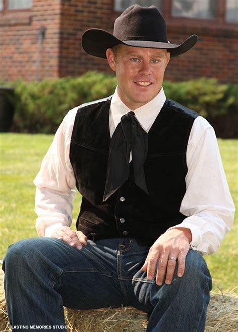 Amp up cowboy style attire with dressy black best   My
