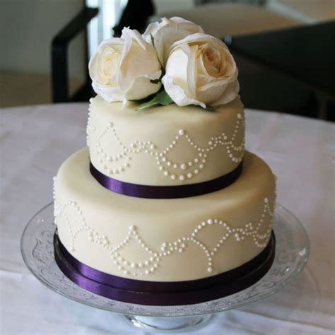 Wedding Cake   2 tier, purple with silk ribbon and hand