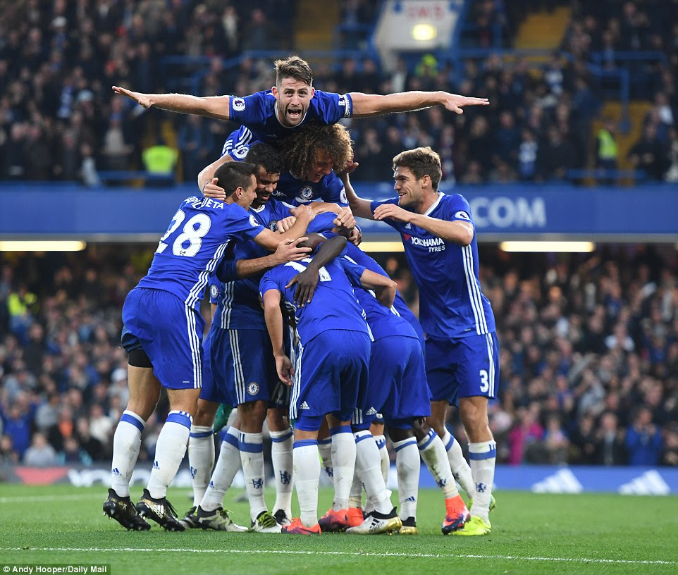 Chelsea players celebrate a stunning victory against Jose Mourinho's Manchester United in the Premier League