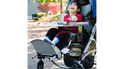 boy with cerebral palsy in medical stroller