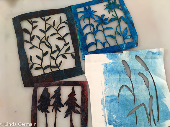 paper stencils cut from a recycle tyvek envelop