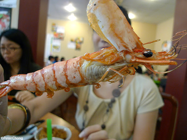 sea barbecued prawn with head peeled open