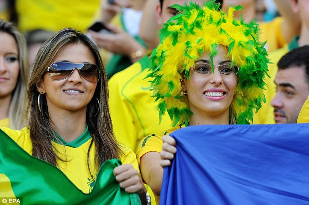 Colourful: Brazil fans enjoy the atmosphere at Belo Horizonte for the semi-final