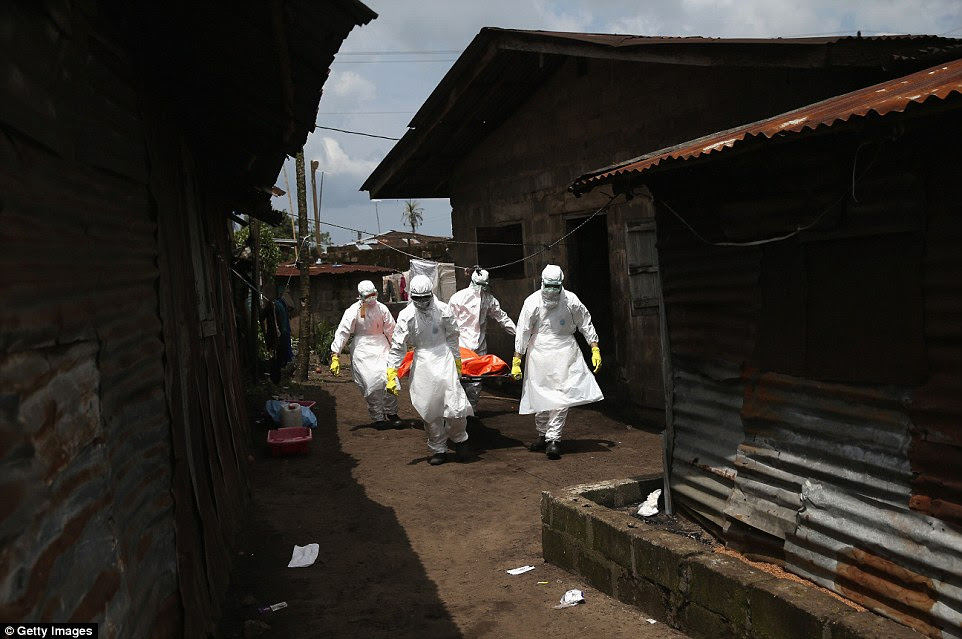 Taken away: Most cases of Ebola - which can cause a temperature and vomiting - were recorded in Liberia, Guinea and Sierra Leone