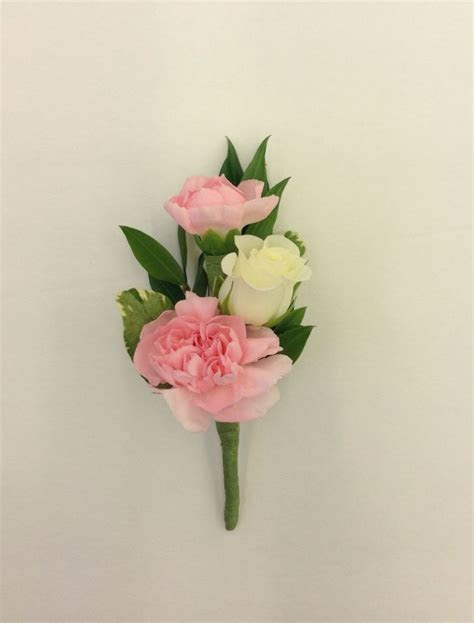 Pink and white boutonniere with mini carnations and spray