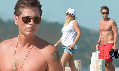 Rob Lowe, 51, shows of toned figure