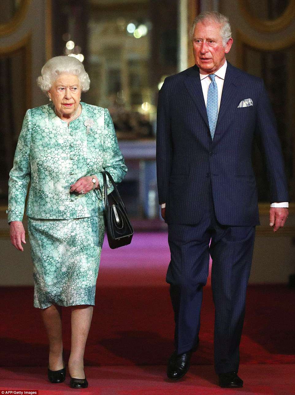 The Queen and Prince Charles welcomed dozens of world leaders to feast at Buckingham Palace for a state dinner on Thursday evening. Pictured: The two earlier in the day