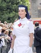 La crocerossina oggetto di un plateale gesto di  apprezzamento da parte di Silvio berlusconi il due giugno. duranta la  parata militare a Roma per la festa della Repubblica