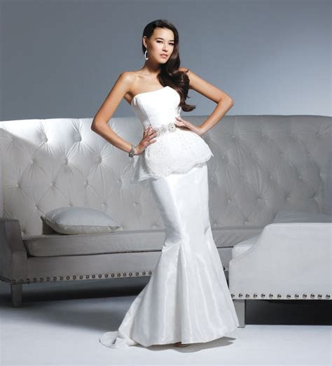 White strapless mermaid wedding dress by David Tutera by