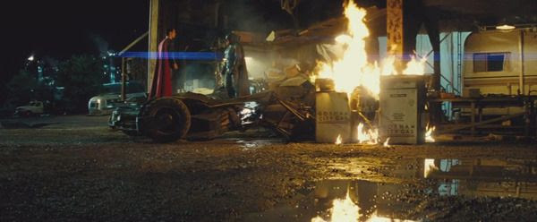 Emerging from the Batmobile, the Dark Knight (Ben Affleck) confronts the Man of Steel (Henry Cavill) in this scene from the BATMAN V SUPERMAN: DAWN OF JUSTICE Comic-Con trailer.