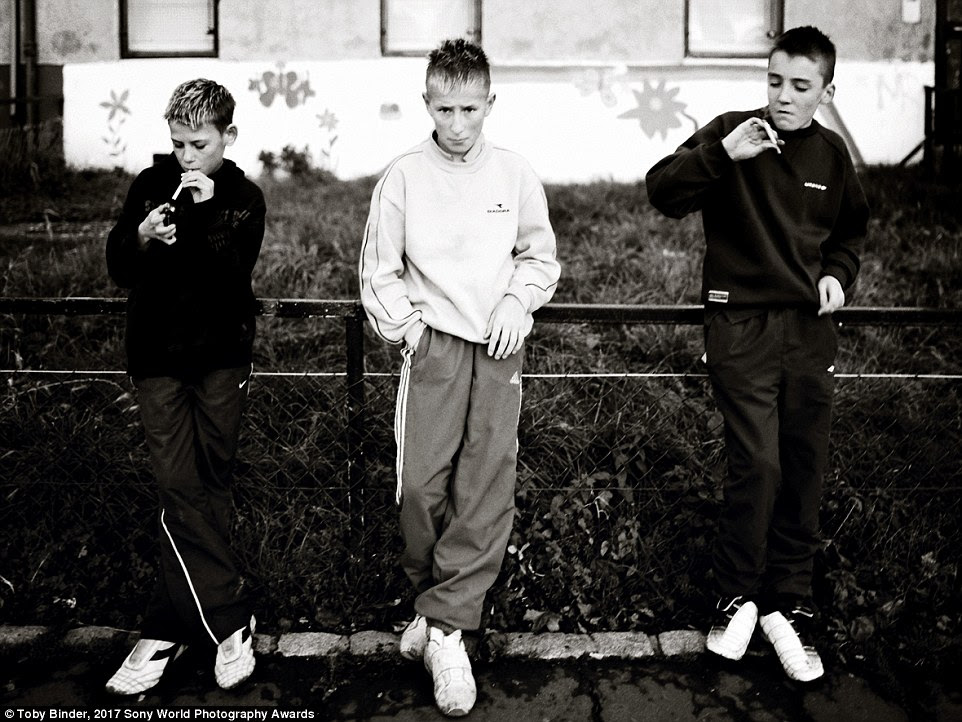 In Edinburgh, Scotland, boys smoke cigarettes in a deprived area with high rates of unemployment, drug abuse and gang activity