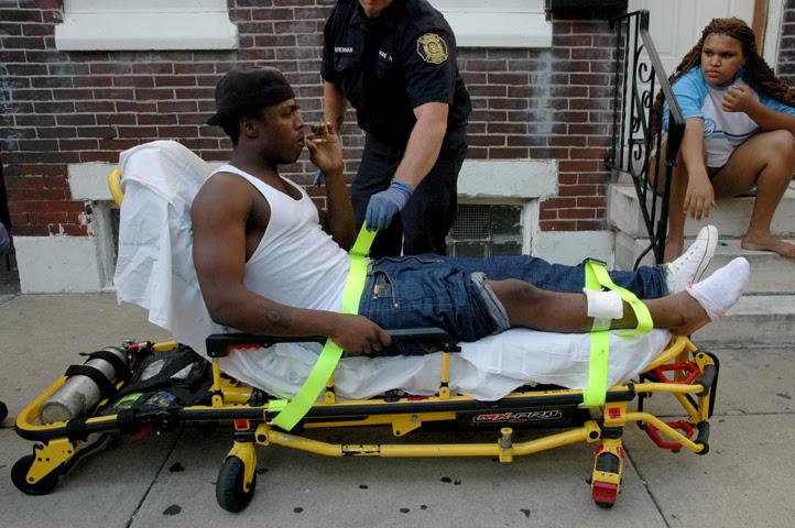 on gurney gunshot in leg web.jpg