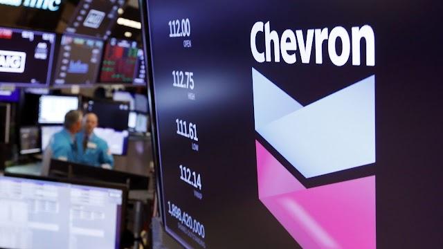 Chevron swung to second-quarter loss as oil demand slumped