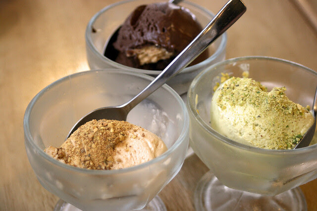 Homemade gelato - hazelnut, dark chocolate with crispy wafer, and pistachio
