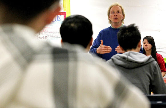 Academic Decathlon coach Larry Welch talks to members of the John Marshall High School team.