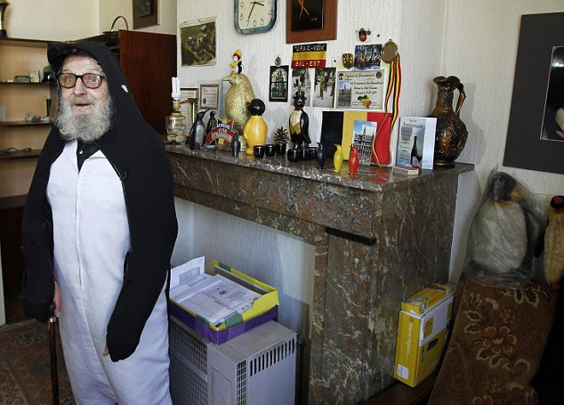 Mr Penguin: Alfred David has spent the last 40 years indulging his obsession with penguins, wearing a costume when he goes out and collection memorabilia