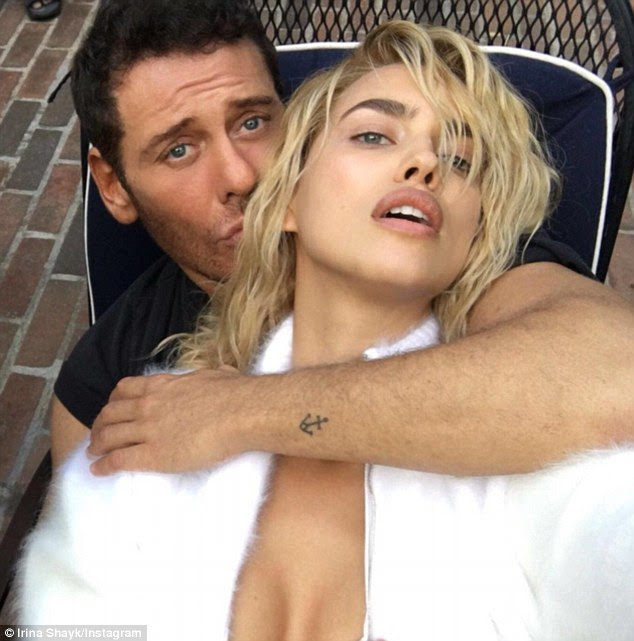 'Double trouble': The Sports Illustrated Swimsuit model showcased the curly shoulder length cut in a sultry pose with celebrity photographer Mert Alas