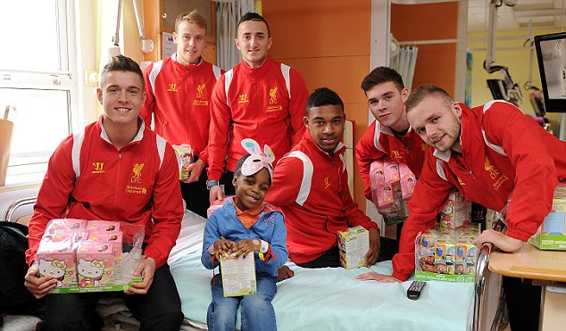 Easter bonus: The Liverpool youth players dropped into Alder Hey Hospital to visit the children